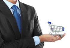 Hand with shopping cart Royalty Free Stock Photo