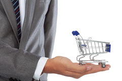 Hand and shopping cart Royalty Free Stock Photos