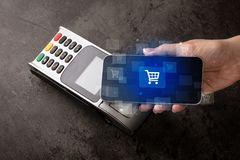 Hand shopping with mobile phone. Easy paying with mobile phone in the market vector illustration