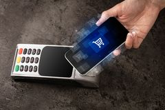 Hand shopping with mobile phone. Easy paying with mobile phone in the marketn stock images