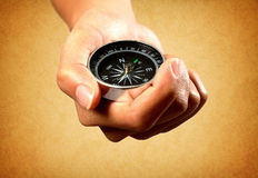 Hand show a compass Royalty Free Stock Photography