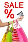Hand show credit cards  with shopping bags with Sale sign Royalty Free Stock Photo