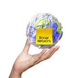 Hand show crumpled world and social network sticky note as conce Royalty Free Stock Images
