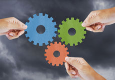 Hand show gear to teamwork as concept Stock Image