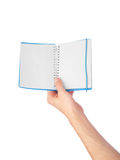 Hand show the opened notebook Royalty Free Stock Image