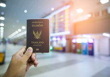 Hand that show the thailand passport at airport.  stock photography
