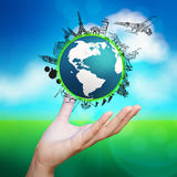 Hand showing airplane traveling around the world Royalty Free Stock Photos