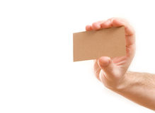 Hand showing blank business card. On white background Royalty Free Stock Image