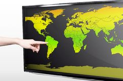 Hand showing blank world map Stock Image