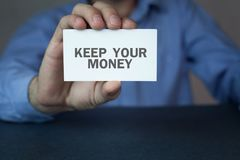 Hand showing business card with a keep your money word. Stock Photos