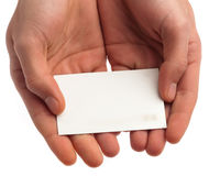 Hand showing a card Stock Photo