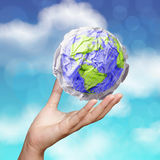 Hand showing crumpled world paper symbol stock photo
