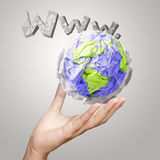 Hand showing crumpled world paper Stock Images
