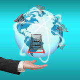 Hand showing 3D globe world map of shopping carts worldwide Stock Images