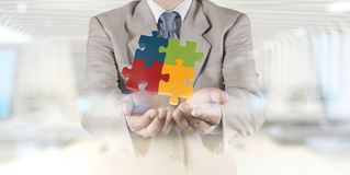 Hand showing 3d puzzle as concept Stock Photos