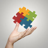 Hand showing 3d puzzle as concept Stock Photo