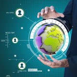 Hand  showing globe around with arrow Stock Photos