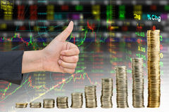Hand showing good in graph from coin. Mix stock exchange graph background stock images