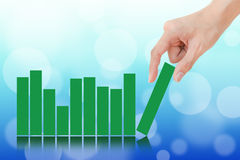 Hand showing graph Stock Image
