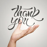 Hand showing hand drawn design word THANK YOU Stock Images