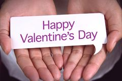 Hand showing Happy Valentine`s Day. Royalty Free Stock Photos