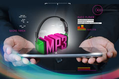 Hand  showing head phone with mp3 Royalty Free Stock Photography