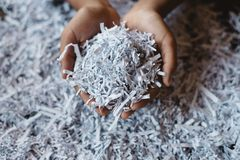Hand showing heap of shredded paper. royalty free stock images