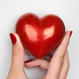 Hand showing heart Stock Images