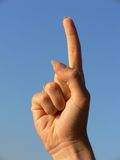 Hand showing the index finger. (direction/warning sign Stock Photo