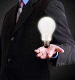 Hand showing lamp, idea concept Stock Photography