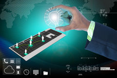 Hand showing the light bulb and computer keyboard Stock Photos