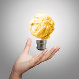 Hand showing light bulb crumpled paper Stock Photos