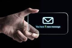 Hand showing a new message on transparent 3D smartphone. With black background. A 3D phone is a mobile phone that conveys depth perception to the viewer by stock photo