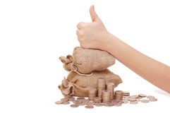Hand showing o'key, bag with coins Stock Images