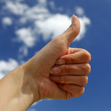 Hand showing OK sign. With blue sky in the background Stock Images