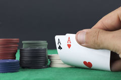 Hand showing a pair of aces Stock Photo