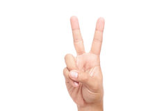 Hand showing peace sign or victory sign. Man hand showing peace sign or victory sign isolated on white background Royalty Free Stock Image