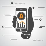 Hand showing phone with bitcoin graph going down Stock Images