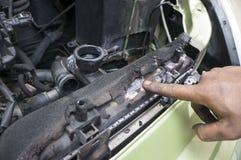 Hand Showing Radiator Leak Stock Images