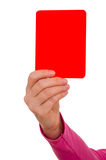 Hand is showing a red card. Female hand is showing a red card Stock Photos
