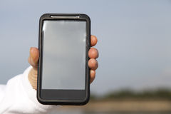 Hand showing smart mobile phone with blank screen Stock Photography