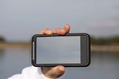 Hand showing smart mobile phone with blank screen Stock Images