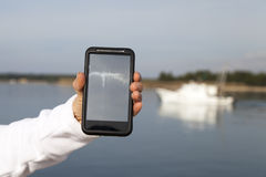 Hand showing smart mobile phone with blank screen Royalty Free Stock Photos