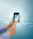 Hand showing smartphone with virtual screen Royalty Free Stock Photo