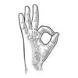 Hand showing symbol okay. Vector black vintage engraved Stock Photography