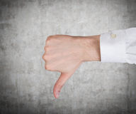 Hand showing thumb down Stock Image