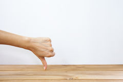 Hand showing thumb down Royalty Free Stock Images