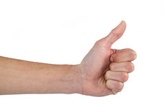 Hand showing thumb up against white background Stock Image