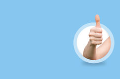 Hand showing thumbs up gesture. stock image