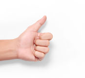 Hand showing thumbs up sign against Royalty Free Stock Photography